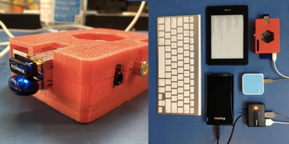Der technische Aufbau im Detail: Man sieht Raspberry Pi, Kindle Paperwhite, Apple Bluetooth-Tastatur, WLAN-Router und USB-Hub.
